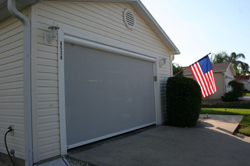 Electric roll up garage screens michele 39 s hide away screens for Roll down garage door screen