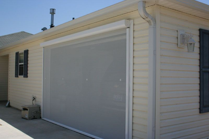 Electric roll up garage screens michele 39 s hide away screens for Roll up screen door for garage